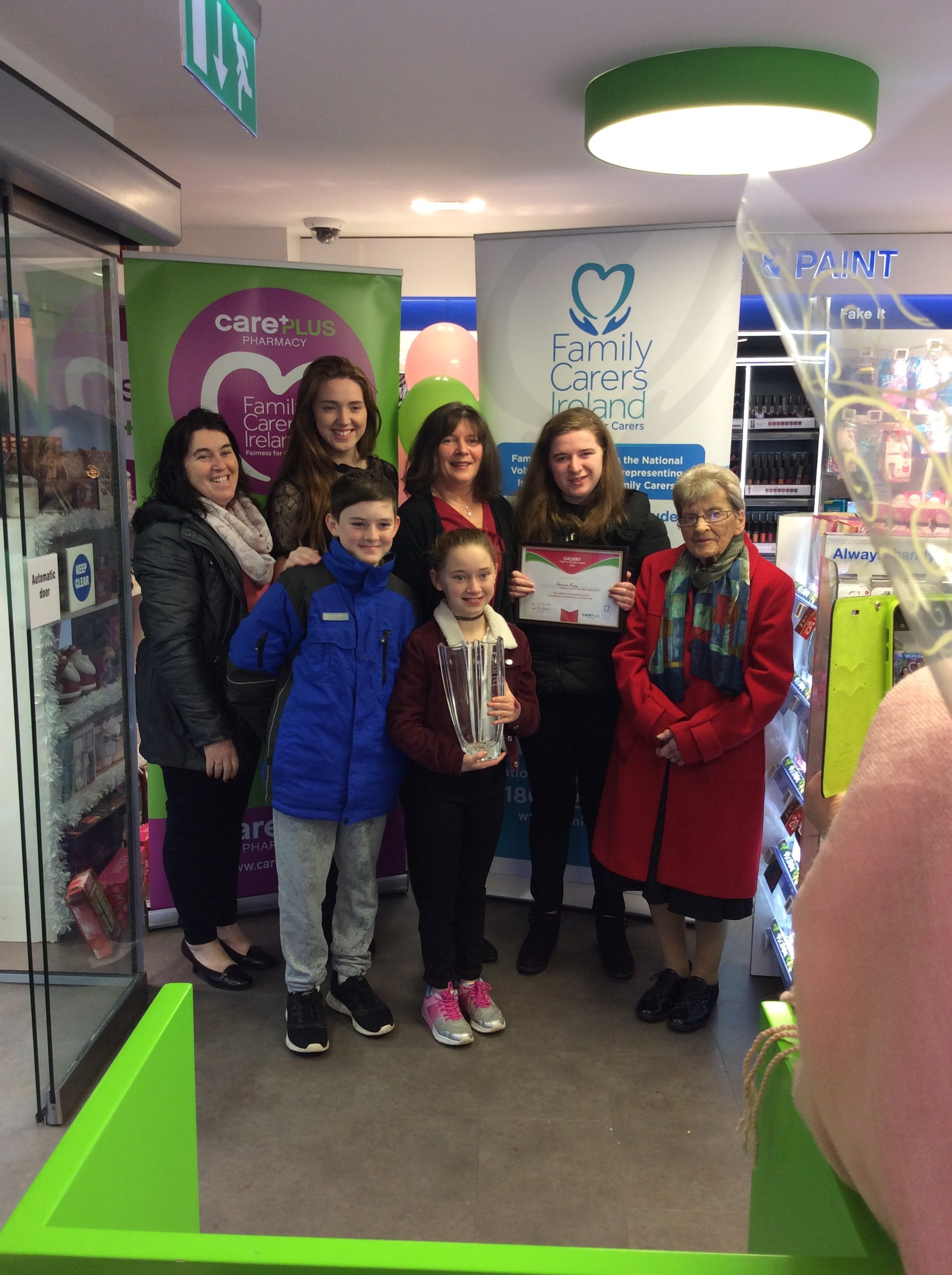 Adrienne Furey and her Family being awarded Galway Carer of the Year at Killian's CarePlus Pharmacy, Loughrea, Co. Galway