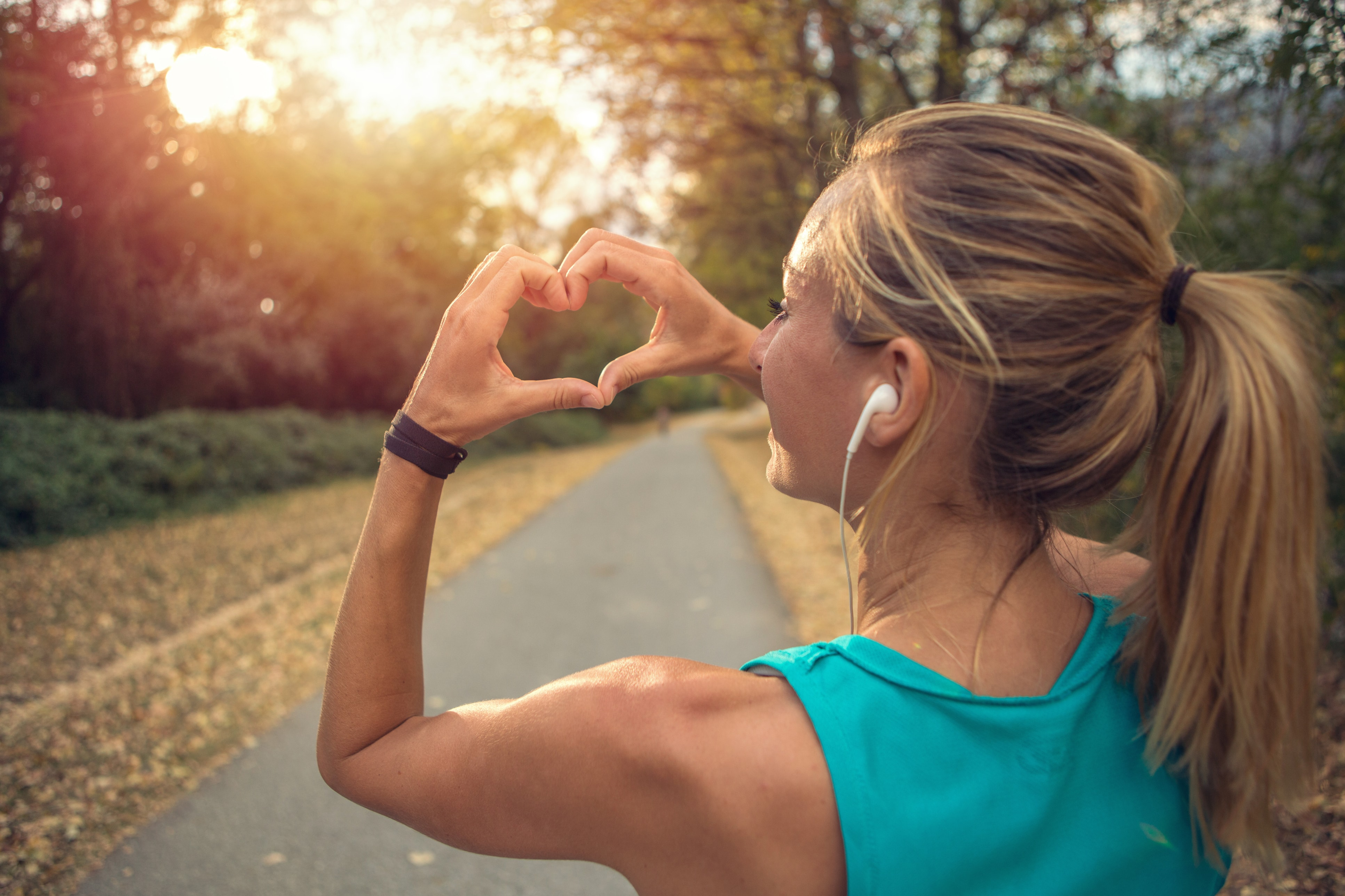 young woman exercising outdoors with a healthy heart